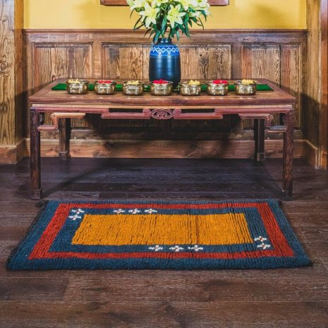 Orange ground sheep wool hand made carpet with blue and red line interior