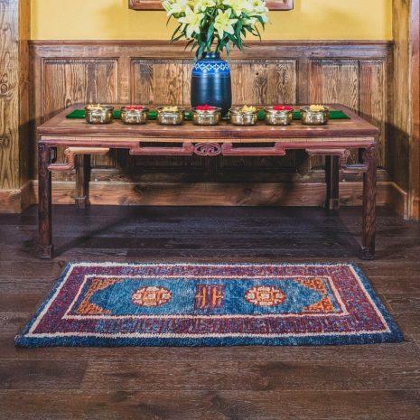 Red ground mandala design sheep wool carpet interior